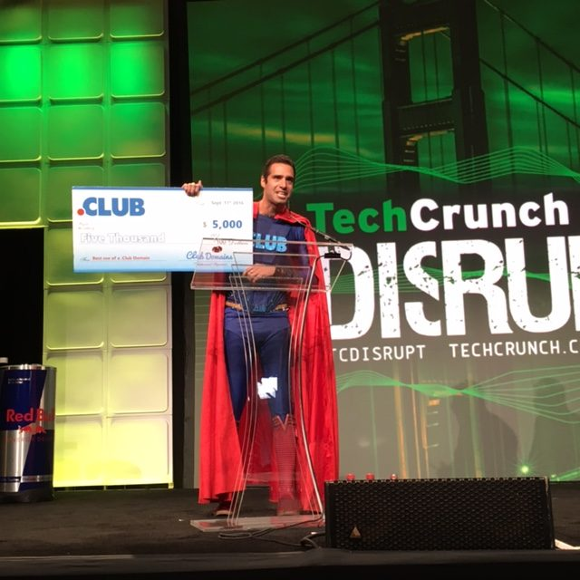 The .CLUB Superhero announcing the $5,000 winner