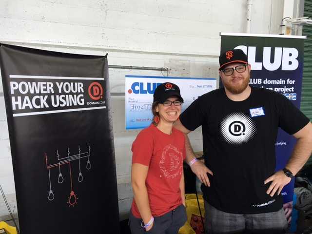 Handing our swag at our booth